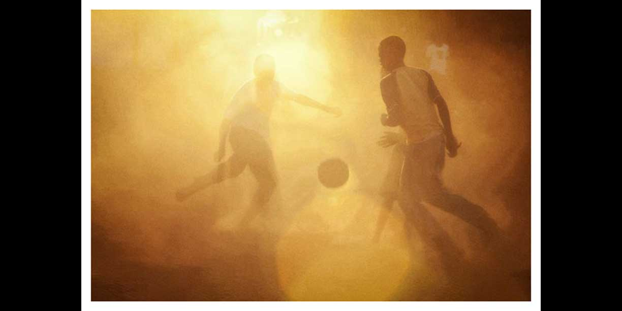 color_image_of_african_village_soccer_at_sunset